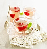 Elderflower jelly with raspberries in cups and glass