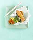 Salmon with teriyaki sauce in greaseproof paper