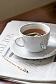 Cup of herbal tea on a newspaper