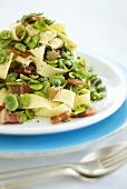Ribbon pasta with bacon and broad beans