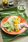 Fish steamed in banana leaf with cucumber salad and mango salsa