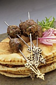 Lamb kebabs on flatbread