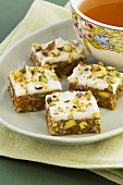 Apricot and pistachio squares and a bowl of tea