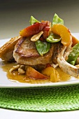Pork chop with mangetout and peach slices
