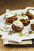 Stuffed mushroom caps topped with goat's cheese