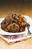 Ossobuco con le olive (Slices of veal shank with olives, Italy)
