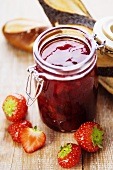 Strawberry jam, fresh strawberries and pretzel rolls