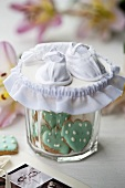 Baby shoes on biscuit jar
