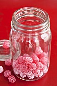 Raspberry sweets in sweet jar
