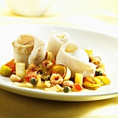 Sole rolls with prawns, capers, leeks and tomatoes