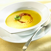 Yellow pepper soup with tomato pesto