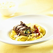 Beef roulade with red wine sauce and ribbon pasta