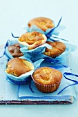 Several banana muffins in blue paper