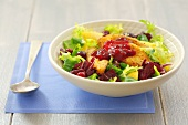Salad leaves with deep-fried sheep's cheese and cranberry jam