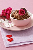 Chocolate mousse with roses and chocolate truffle