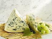 Gorgonzola with grapes on straw mat