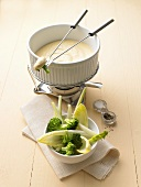 Cheese fondue with broccoli and chicory