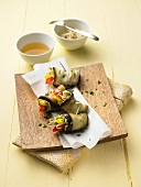 Aubergine rolls filled with peppers and sprouts