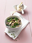 Spinach soup with wild rice and mushrooms