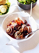 Snails and carrots in red wine sauce