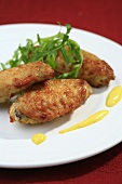 Chicken wings with rocket