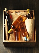 Several bottles of white wine in wooden box