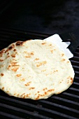 Flatbread on barbecue rack