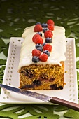 Sour cherry cake with yoghurt icing and berries