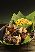 Chicken drumsticks with green tea leaves and sweetcorn salad (Asia)