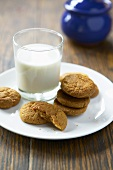 Soetkoekies (South African spiced biscuits) with milk