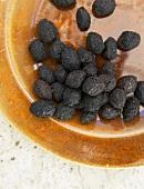 Getrocknete schwarze Oliven