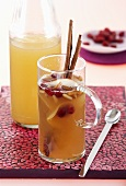Apple and pear punch with dried cranberries and toasted pine nuts
