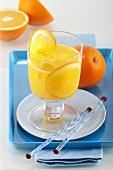 Orange juice with slices of orange