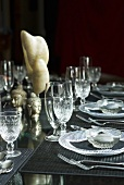 Laid table with glass tableware and Asian decorations