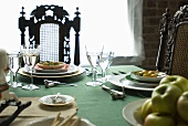 Laid table with fruit on plates