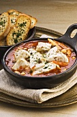 Fish stew with chick-peas, toasted bread