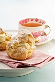 Profiterole with cream filling, tea