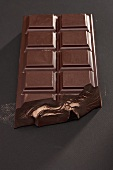 A bar of dark chocolate, broken