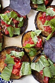 Marinated aubergine slices with tomato and basil