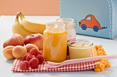 Baby food in jars and fresh fruit