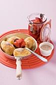 Semolina dumplings with plum compote
