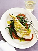 Swordfish steak on tomato and bean salad