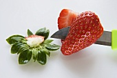 Strawberry, almost cut in half
