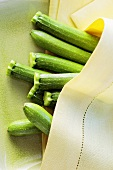 Several courgettes between cloths