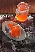 Quince jelly on plate and in preserving jar