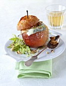 Baked apple stuffed with nuts and Roquefort