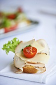 Canape with ham and cherry tomato