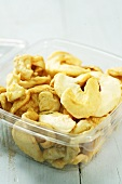 Dried apple rings in plastic container