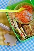 Omelette, rice with carrots and mandarin orange in lunch box
