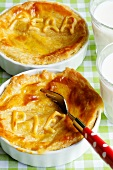 Pear pies and glasses of milk
